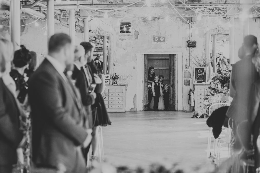 Doors open for the bridal party to walk down