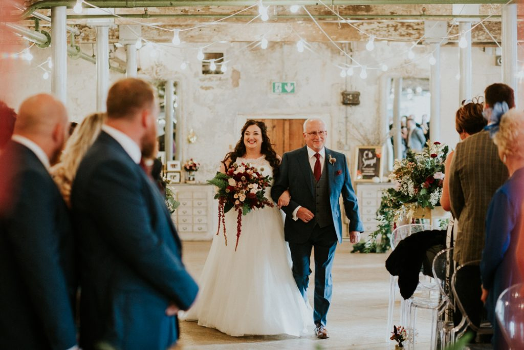 Bride and Dad walking down the aisle at Holmes Mill