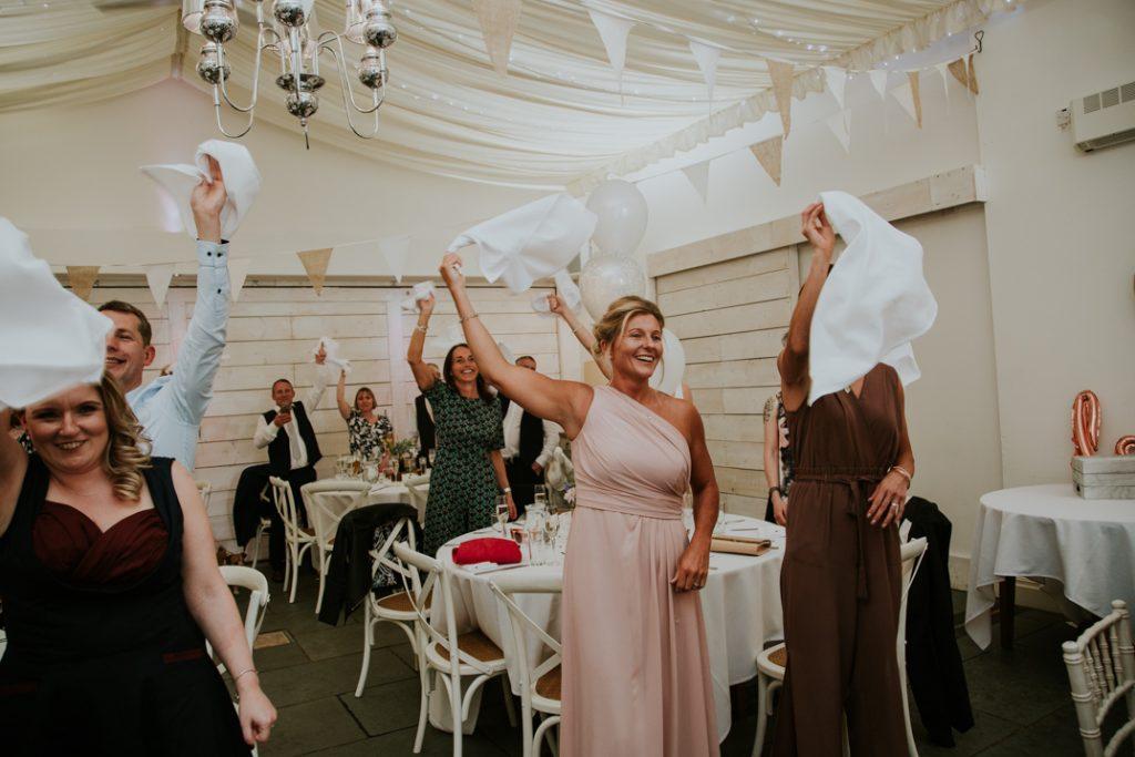 guests waving napkins
