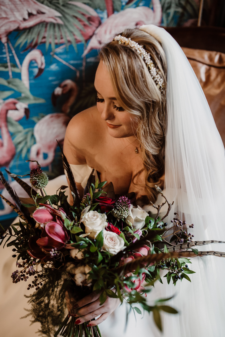 Bride sitting on a chair in the window light at the spinning block, holmes mill wedding photography