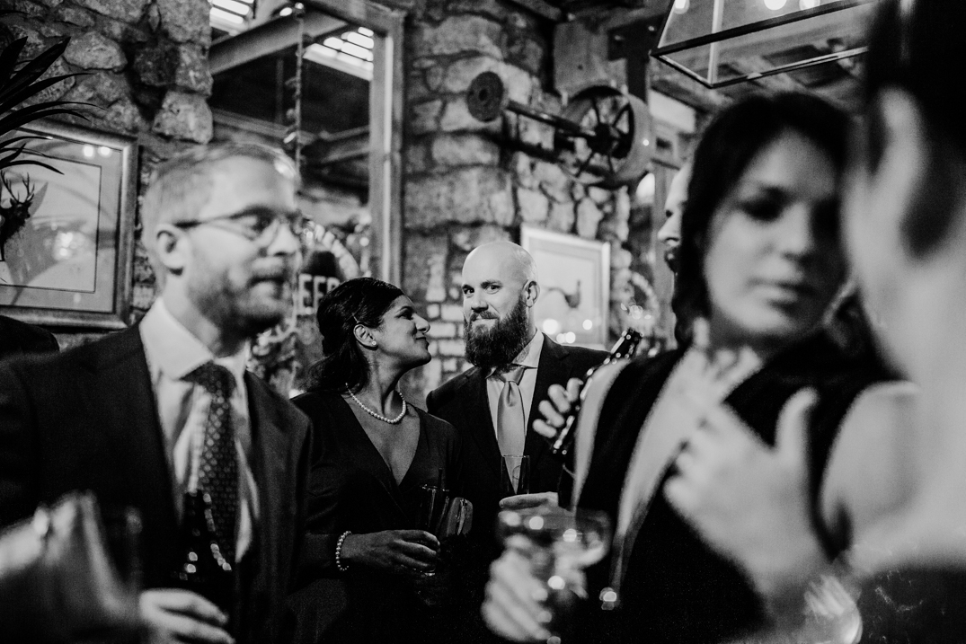 Guests talkign in the beer hall at Holmes mill