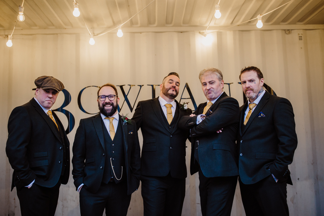 The groomsmen stood in the crate outside the bowland brewery