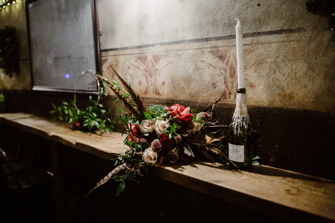 Flowers by wildfire floral photographed in the engine room next to a candle