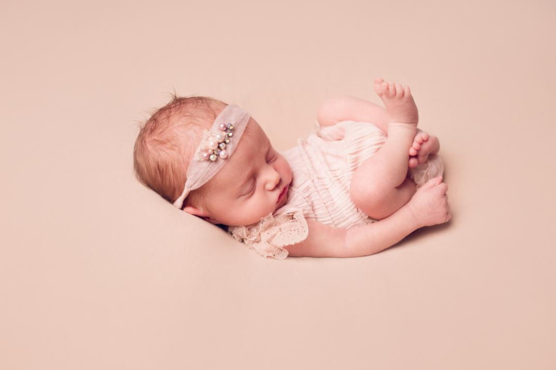 newborn photography baby on a beanbag